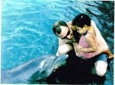 family activities, swiming with the Dolphins in ohco Rios
